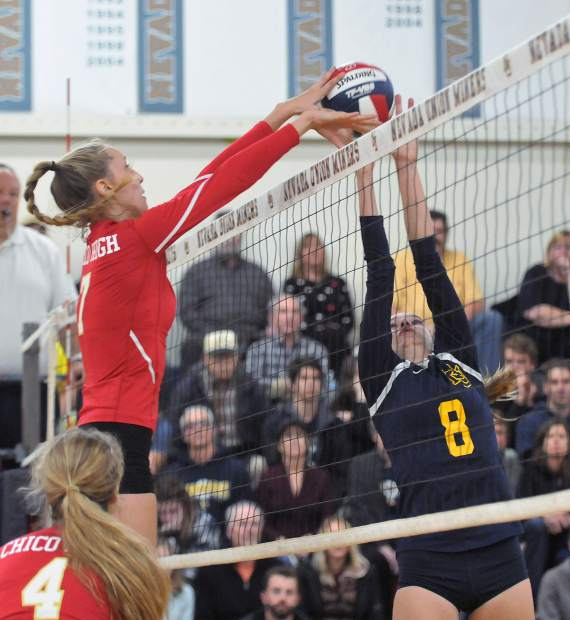 Chico High School's Hannah Houston (7) gets the upper hand over Nevada Union's Bekah McGill (8), with the block for a point during the Miners' CIF NorCal Division 2 tournament matchup against the Panthers. The Miners would have to overcome many blocked shots by the Panthers en route to their five set victory Wednesday night.