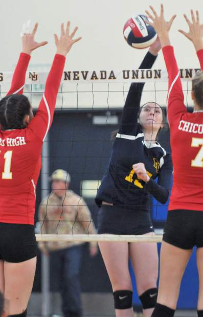 Nevada Union senior Danica Minard (15) gets the ball past the Chico front line during the Miners' five set win over the Panthers.