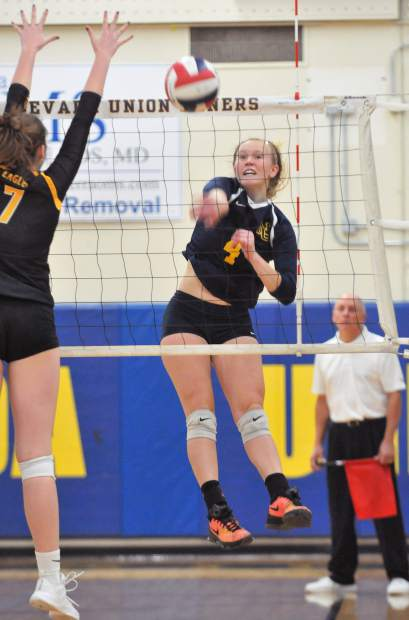 Nevada Union senior Regan Heppe gives a forceful spike over the net for one of the final points of the game against the Del Oro Eagles Tuesday night. Heppe scored nine kills to go with four aces.