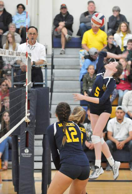 Nevada Union Sophomore Faith Menary (5) spikes the ball over the net against the Del Oro Eagles during Tuesday nigh'ts semi-final playoff win.
