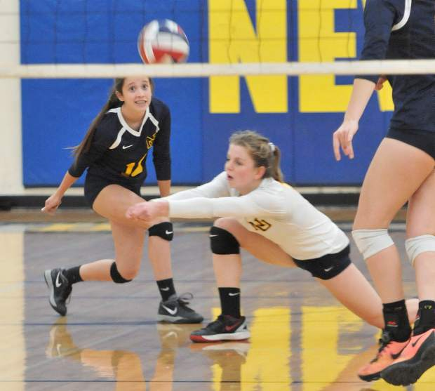 Eliza Hales digs for the ball during Tuesday's playoff matchup against Vista Del Lago High School.