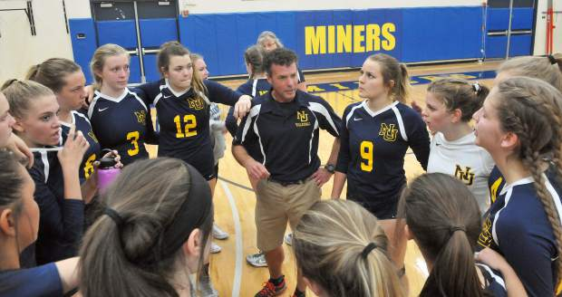 Nevada Union Lady Miners volleyball head coach Chrys Dudek talks to his team during a time out of the second of three sets. The Miners beat Vista Del Lago High School Tuesday night in three sets.