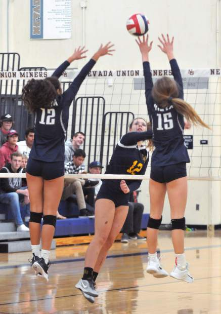 Nevada Union's Meadow Aragon lobs the ball over the net and splits the Vista defense during Tuesday's win in three sets over the Eagles.