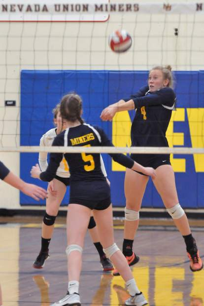 Nevada Union's Regan Heppe (4) bumps the ball during Tuesday's first round playoff game.