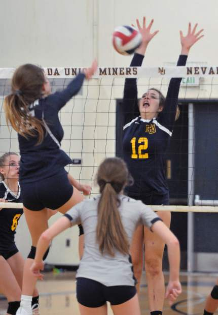 Meadow Aragon goes up for a block against the Vista defense.