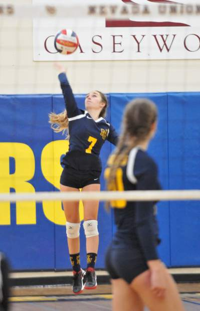 Nevada Union senior Lauren Engleking serves during a playoff game against Vacaville Thursday. The Lady Miners won in five sets.