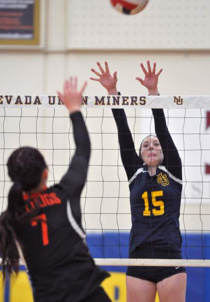Nevada Union's Danica Minard goes up for a block during a playoff game against Vacaville Thursday.