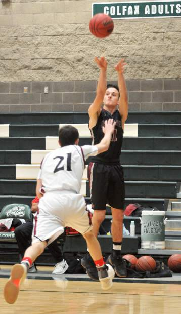 Clay Corippio fires off one of his three point baskets for the night during Thursday's tournament matchup against the Clear Lake Cardinals.