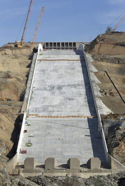 Work continues on the Oroville Dam spillway, Thursday, Nov. 30, 2017, in Oroville, Calif. California water officials and the construction manager said Thursday, that recently found hairline cracks on the spillway are normal and expected in reinforced concrete because it shrinks as it cures. (AP Photo/Rich Pedroncelli)