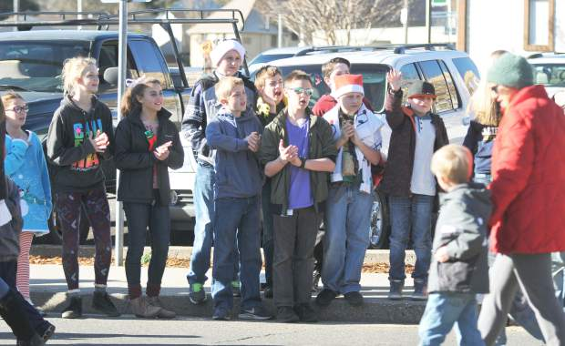 Area youth cheer on the young school children participating in this year's Donation Day along South Auburn Street Thursday morning.