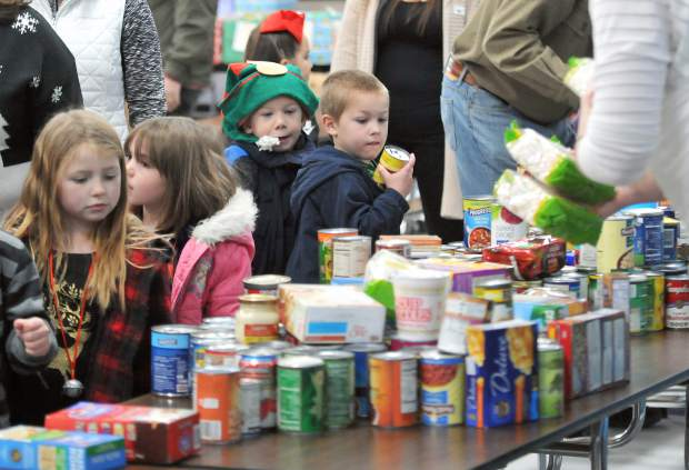 Area school children place their canned goods on a table at Grass Valley Charter School where donations for Donation Day were collected.