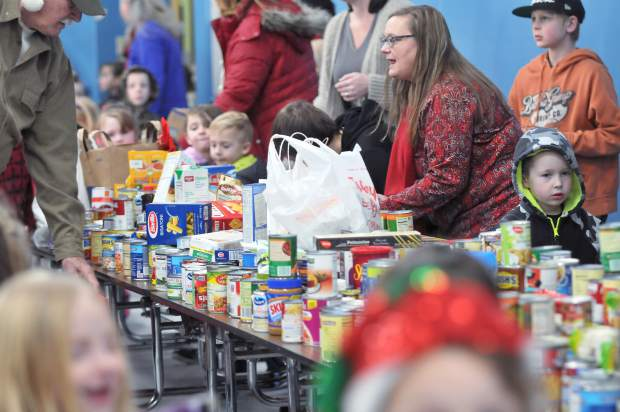 Donation Day organizers help sort donated food Thursday morning at Grass Valley Charter School where area students keep with a century-old tradition of helping Nevada County's needy. The goods, once organized and boxed, were then sent to Interfaith Food Ministry.