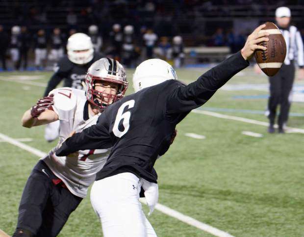 Bear River defensive end Jake Leonard pulls down Capital Christian's quarterback for a sack during a playoff game. The Bruins tallied seven sacks in the game.