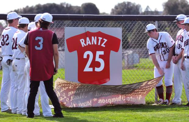 The Bear River High School baseball team's senior class members unveiled a memorial to former teammate Joe Rantz along the right field fence prior to their league opener against Center High School.
