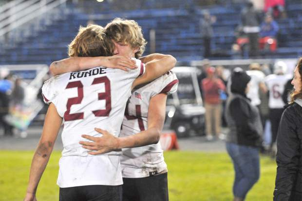 Bear River's Calder Kunde and Tre Maronic embrace after losing to Fortuna in the CIF NorCal 5-A Regional Bowl Game Saturday.