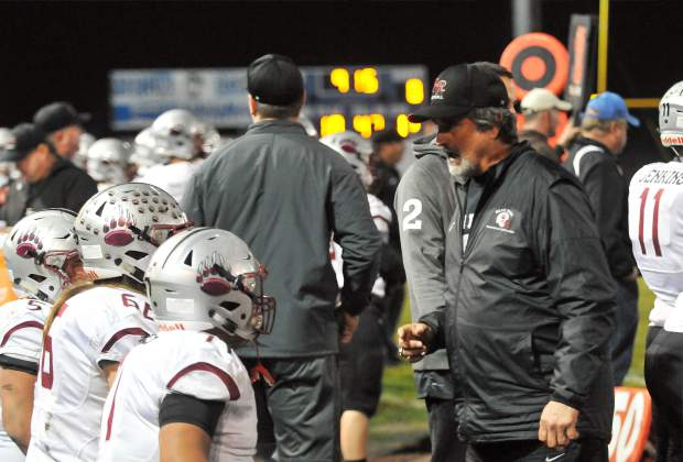 Bear River co-head coach Scott Savoie talks with the Bruins lineman during the CIF NorCal 5-A Regional Bowl Game against Fortuna Saturday.