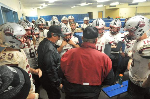 Bear River co-head coaches Scott Savoie and Terry Logue talk with the Bruins during halftime of the CIF NorCal 5-A Regional Bowl Game Saturday.