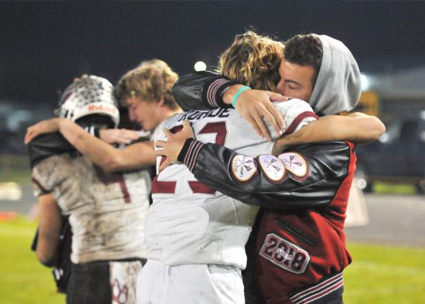 Bear River players embrace after losing the CIF NorCal 5-A Regional Bowl Game against Fortuna.