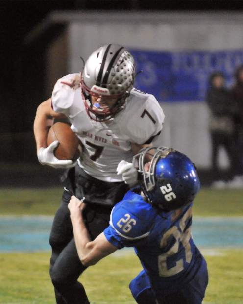 Bear River's Dylan Scott tries for extra yards after a catch during the CIF NorCal 5-A Regional Bowl Game against Fortuna.