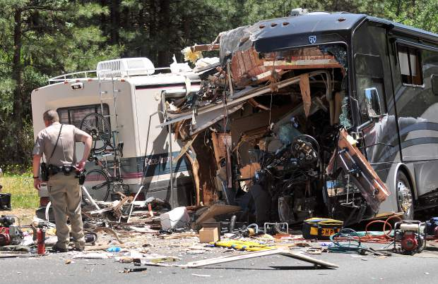 A CHP officer assesses the scene of a two-RV head-on collision after the victims of the crash had been extricated Tuesday afternoon on the 13000 block of Highway 49 near the Golden Chain Motel south of Grass Valley.