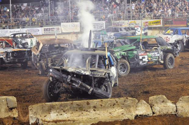 Steam from a busted radiator shoots into the sky after a derby vehicle sustains a hit during Sunday's destruction derby at the Nevada County Fair.