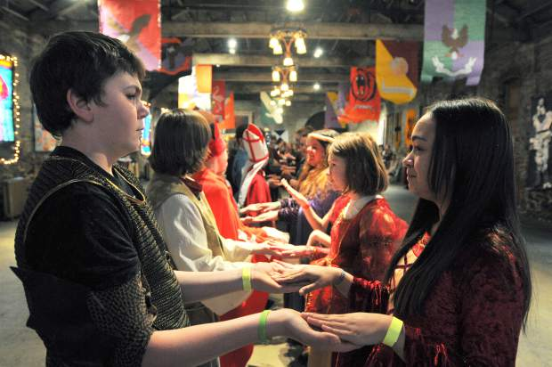 Kate Hershberger, right, is ready to dance with a reluctant looking Haiden Swan during a traditional period dance at the Stone Room of the Miners Foundry.