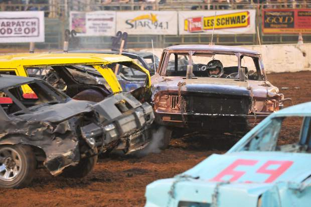 A destruction derby driver dodges cars while trying to deliver hits of his own during the 2017 Nevada County Fair destruction derby.