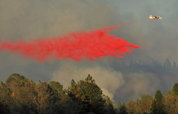A S2T air tanker makes a drop of fire retardant on the Ponderosa Fire Tuesday afternoon near Lumpkin Road.