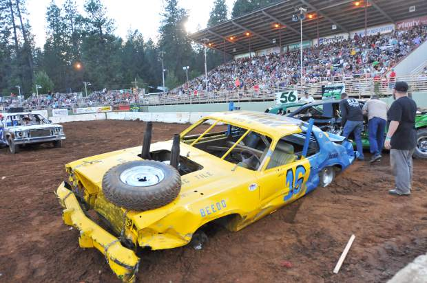 A derby vehicle leans to one side after losing a wheel during a heat of the annual Nevada County Fair destruction derby.