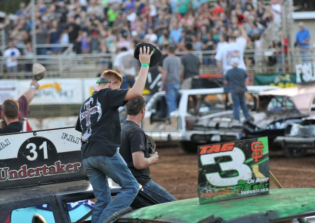 Derby drivers and their crew enter the arena for the singing of the national anthem.