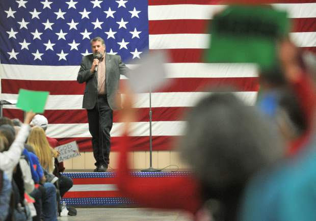 U.S. Representative Doug LaMalfa speaks to an unsettled crowd of constituents duing a town hall held at the Nevada County Fairgrounds earlier this year.