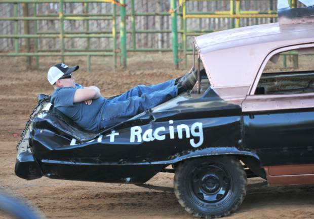 A pit crew member takes a reclined ride back to the pit after the singing of the national anthem.