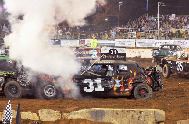 Brian Holt in his Undertaker car sustains a busted radiator, sending steam into the air.