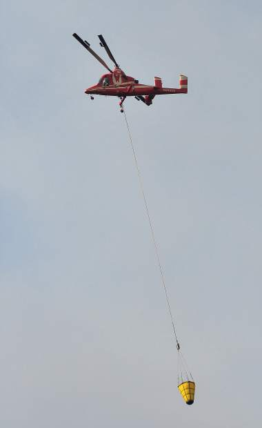 Sky crane helicopters joined in the firefight of the Lobo Fire Monday afternoon off of Bitney Springs Road.