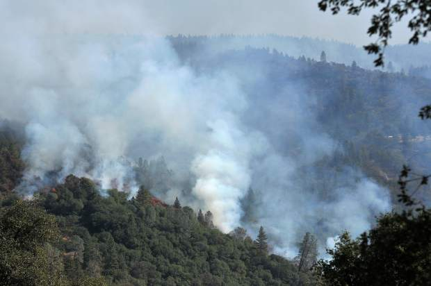 Plumes of smoke from the Lobo Fire emanate from a ridge below Bitney Springs Road near Lake Wildwood Monday afternoon.
