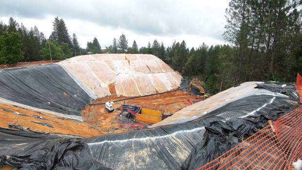 Dirt excavated from the Little Wolf Creek sinkhole along Freeman lane, sits covered in plastic tarping to protect from the rain.