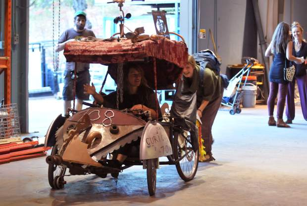 Some Curious Forge members have a little fun in one of the creations on display during Thursday's open house.