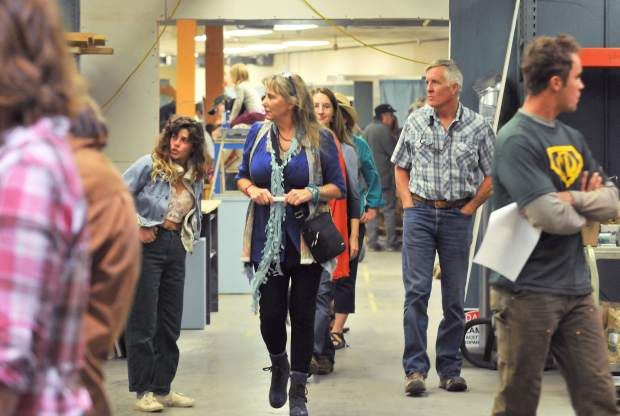 Folks meander through the Curious Forge's new 20,000 foot makerspace located off of Bitney Springs Road, during the Forge's open house Thursday evening.