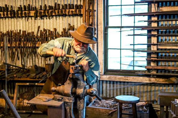 Hal the blacksmith working his craft in the machine shop at the Empire Mine photo walk with Nevada City Scenics last month.