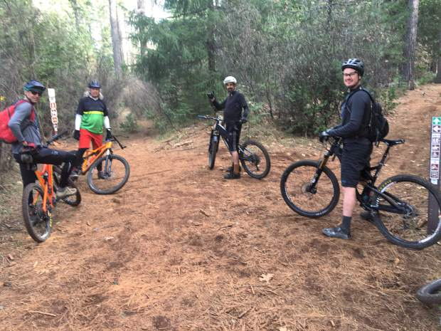 Local mountain bikers all smiles at the hoot trail.