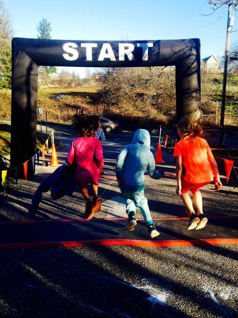 A trio of young runners head toward the starting line at a Resolve2Run event several years ago.