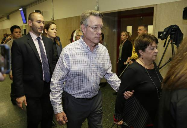 File - In this Nov. 30, 2017 file photo, Jim Steinle, center, and Liz Sullivan, right, the parents of Kate Steinle, walk to a court room for closing arguments in the trial of Jose Ines Garcia Zarate accused of killing their daughter, in San Francisco. A jury has reached a verdict Thursday, Nov. 30, 2017, in the trial of Mexican man at center of immigration debate in the San Francisco pier shooting. (AP Photo/Eric Risberg, File)