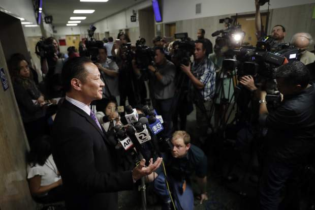 San Francisco Public Defender Jeff Adachi, left, answers questions after a verdict was reached in the trial of Jose Ines Garcia Zarate Thursday, Nov. 30, 2017, in San Francisco. A jury on Thursday found Garcia Zarate not guilty on possible charges of first-degree murder, second-degree murder and involuntary manslaughter in the 2015 death of Kate Steinle on a popular pier. Jurors did find Garcia Zarate guilty of being a felon in possession of a firearm. (AP Photo/Marcio Jose Sanchez)