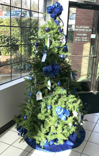 Christmas wishes are hanging from a tree in the Grass Valley Police Department's lobby.