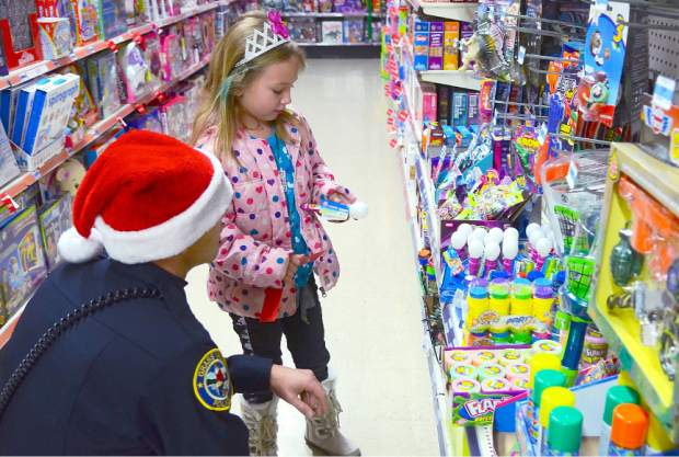 Grass Valley Police officer Zack LaFerriere picks out a Christmas gift with Jordon during a