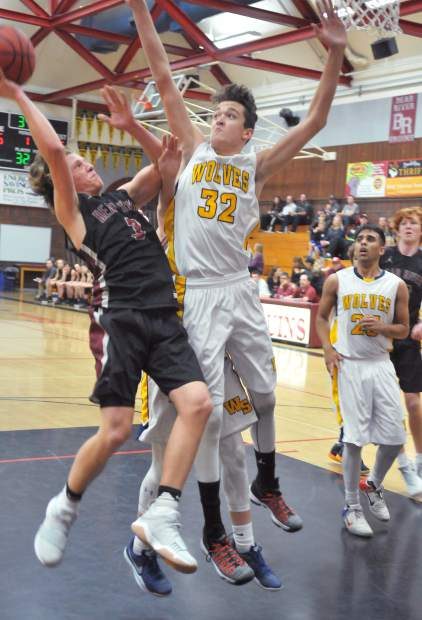 Bear River's Brekyn Vasquez (3) attacks the basket and draws the foul during the Bruins' Ganskie Invitational matchup against the Western Sierra Collegiate Academy Wolves.