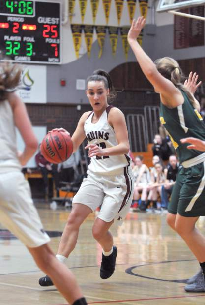 Bear River point guard Katelyn Meylor (21) drives through the Placer defense during the lady Bruins' matchup against the visiting Hillmen.