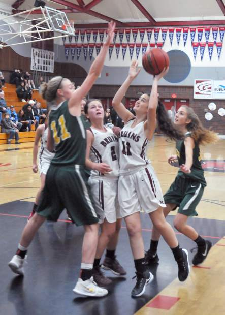 Bear River junior Macey Borcher (11) takes a shot on the basket despite a heavy Placer defense during Wednesday evening's league matchup.