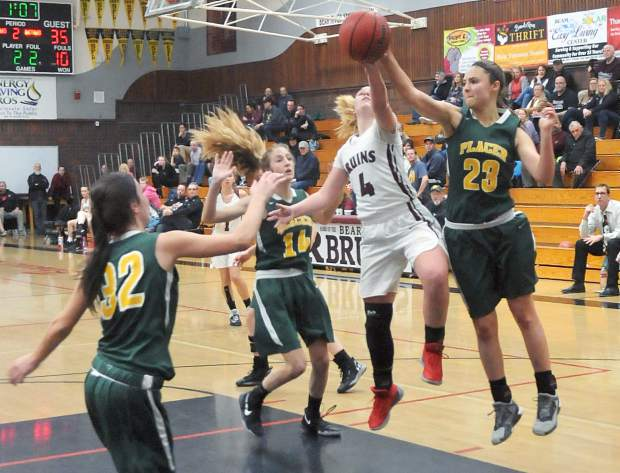 Bear River senior Kylee Dresbach-Hill (4) has her shot blocked by Placer's Madison Mohar. Bear River fell to Placer, 63-35, and is now 0-2 in Pioneer Valley League play.