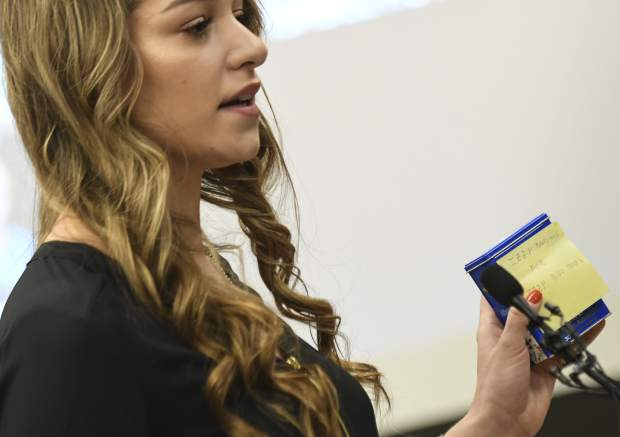 Former gymnast Isabell Hutchins holds up gifts Larry Nassar gave her as she gives a victim-impact statement Tuesday, Jan. 23, 2018, during the sixth day of testimony in Lansing, Mich. Nassar, 54, has admitted sexually assaulting athletes under the guise of medical treatment when he was employed by Michigan State University and USA Gymnastics, which as the sport's national governing organization trains Olympians. He already has been sentenced to 60 years in prison for child pornography. Under a plea bargain, he faces a minimum of 25 to 40 years behind bars in the molestation case. (Matthew Dae Smith/Lansing State Journal via AP)